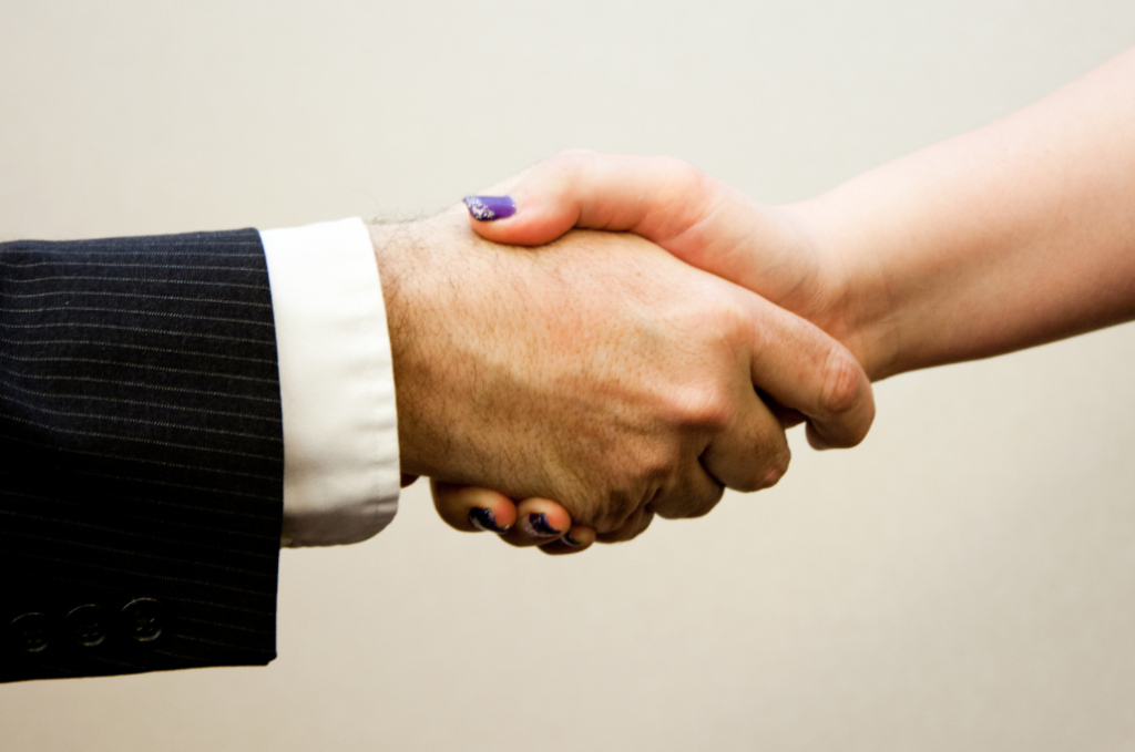 private equity deal handshake