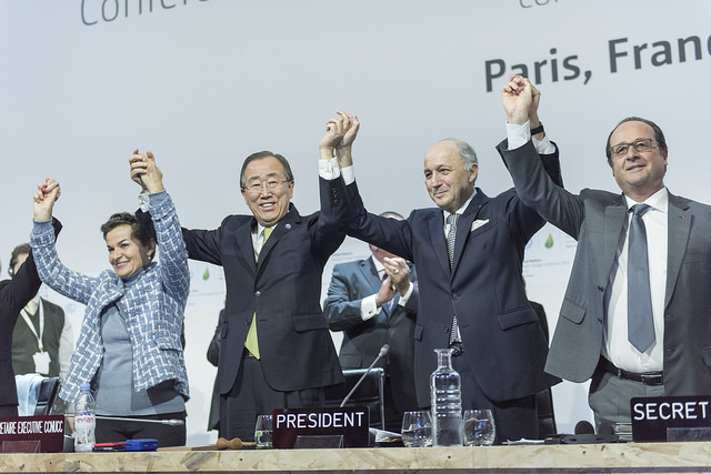 Secretary-General Ban Ki-moon (second left) at the close of the twenty-first session of the UN Framework Convention on Climate Change in Paris.
