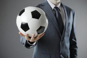 Businessman holding soccer ball