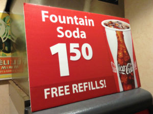 """A sign that reads, """"Fountain soda $1.50. Free refills!"""""""