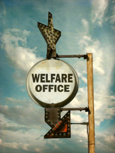 "A sign with an arrow that reads, ""welfare office."""