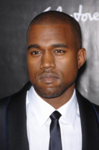 A photo of Kanye West dressed in formal attire.